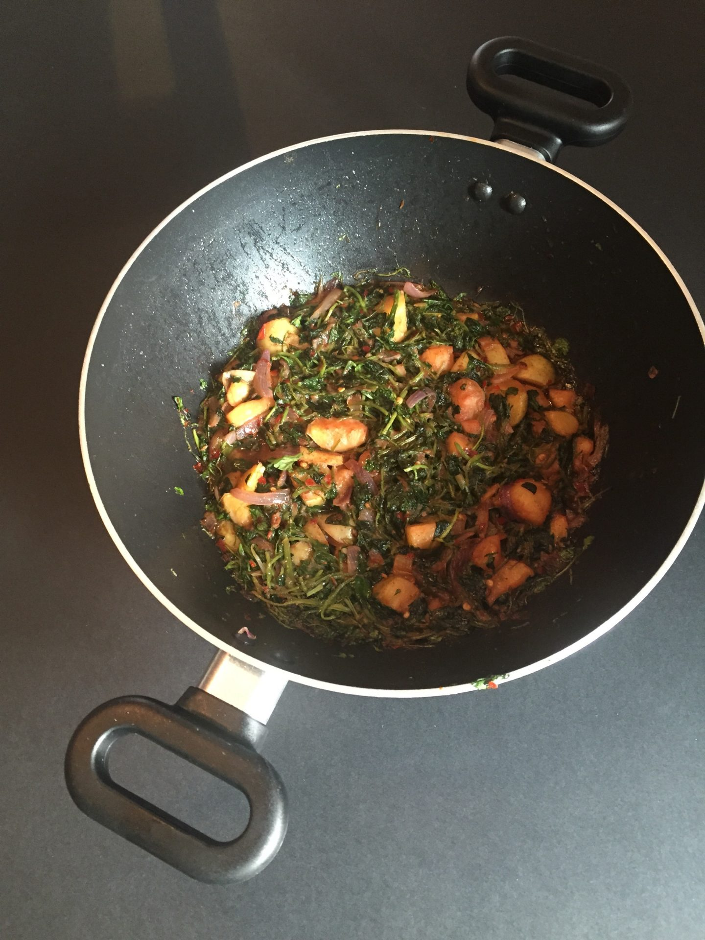 Spiced and sautéed watercress and potatoes
