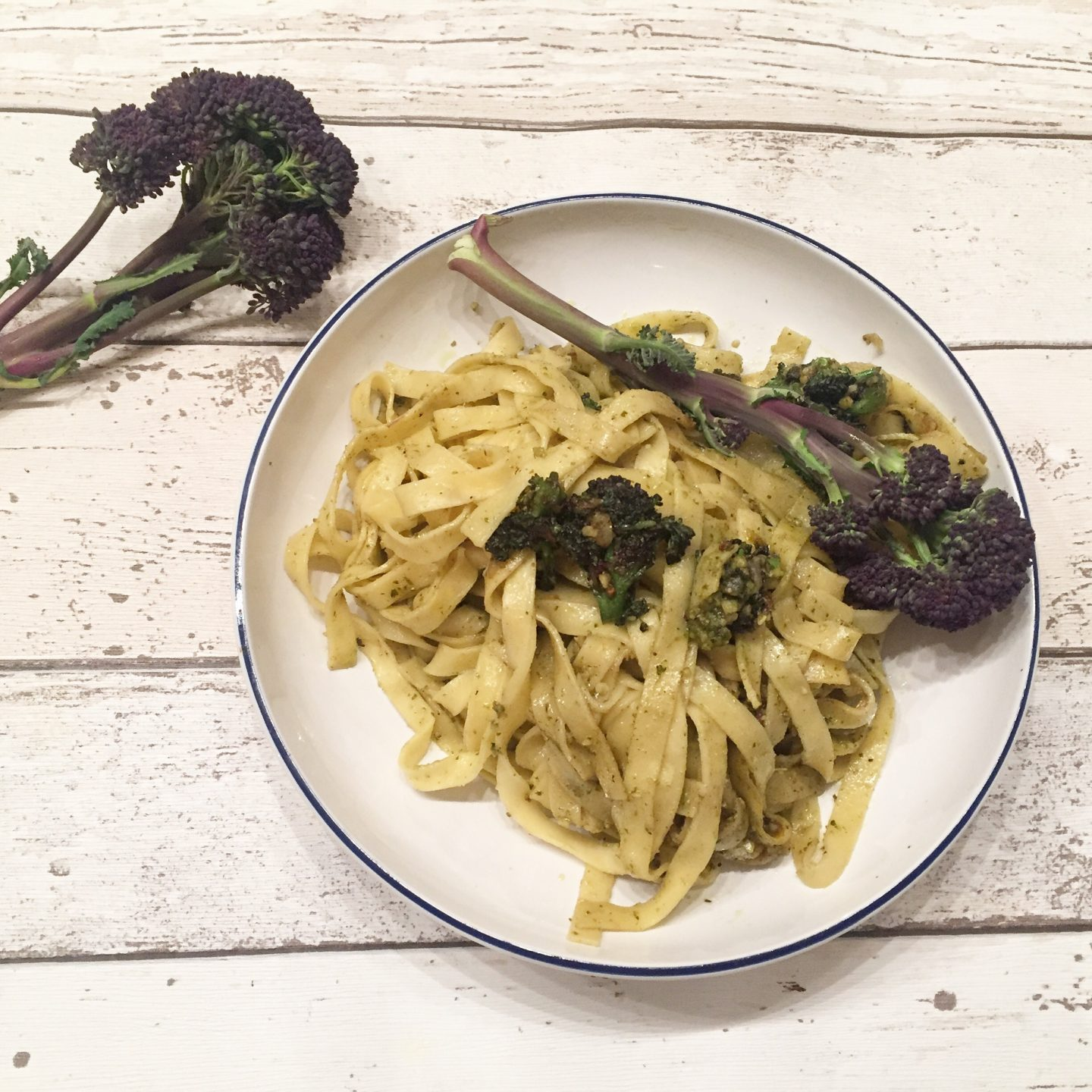 Tagliatelle with pesto, garlic, onions and purple sprouting broccoli